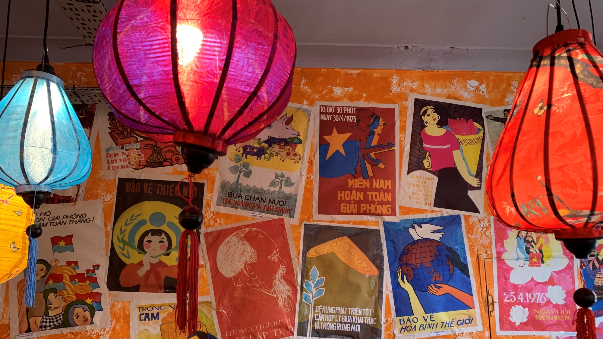 posters and lanterns in nam song caphe